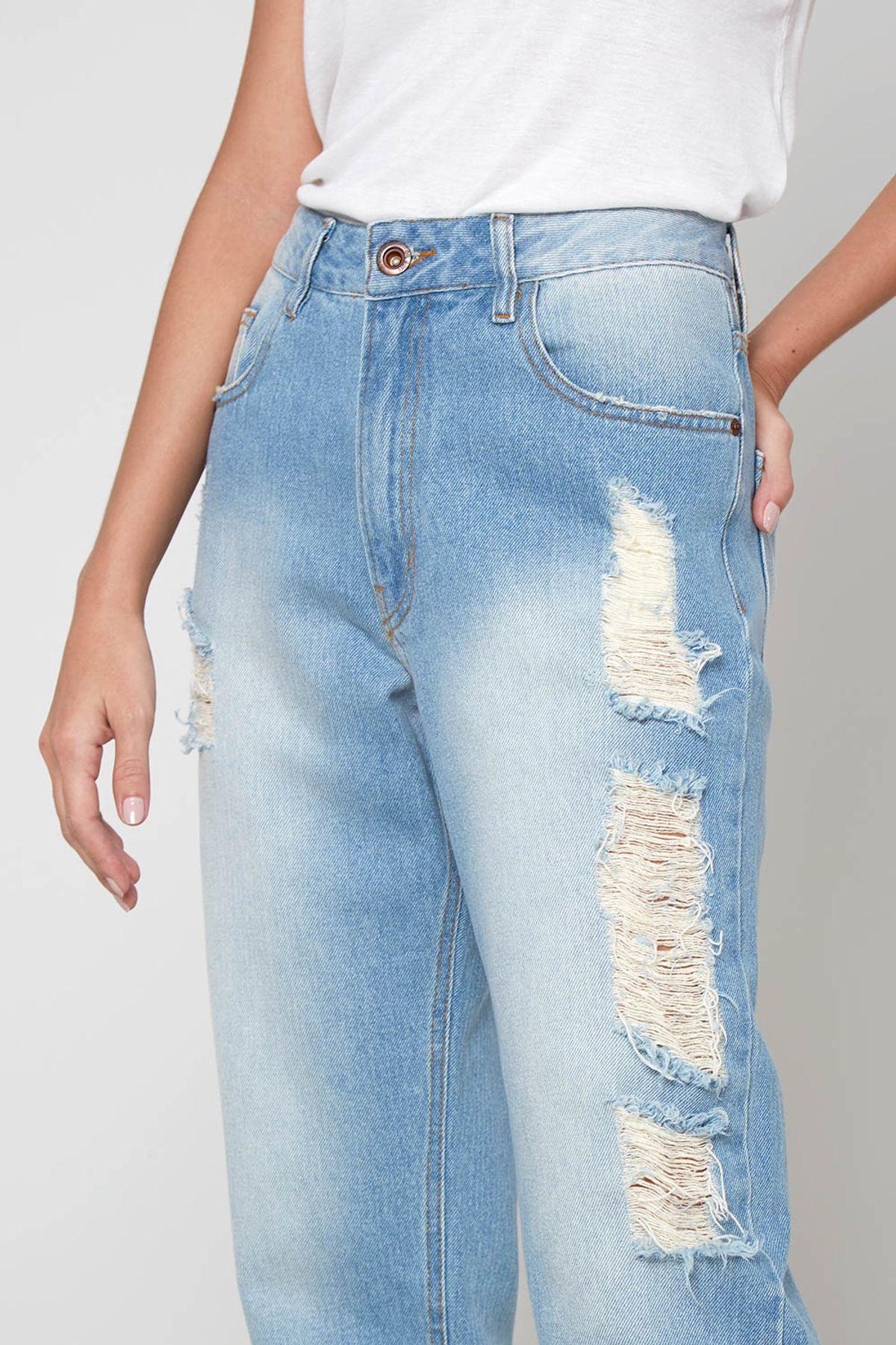 calça jeans detonada estilo rock